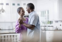Mature African American couple dancing. — Stock Photo