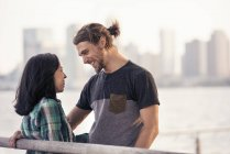 Man and woman by the waterfront — Stock Photo