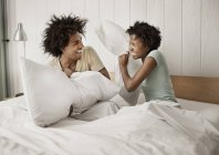 Couple playfighting with pillows. — Stock Photo
