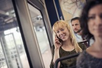 Blond woman on a city bus — Stock Photo