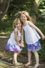 Girls standing in a forest. — Stock Photo