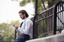 Man checking his cell phone — Stock Photo