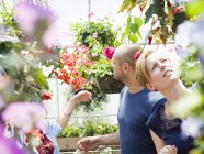 Couple looking at flowers in a garden centre — Stock Photo