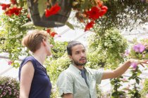 Man and woman in a garden centre — Stock Photo
