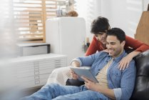 Couple using a digital tablet. — Stock Photo