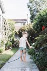 Girl standing on a path in a garden — Stock Photo