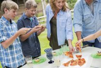 Outdoor family party and picnic. — Stock Photo
