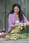 Woman sorting freshly picked vegetables — Stock Photo