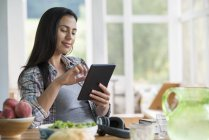 Woman using a digital tablet. — Stock Photo