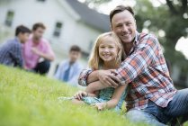 Father and daughter at a summer party — Stock Photo