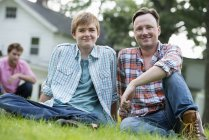 Father and son at a summer party — Stock Photo