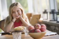 Girl looking with pastry pie — Stock Photo