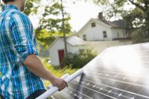 Man with solar panel — Stock Photo