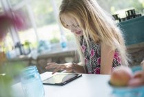 Girl using a digital tablet — Stock Photo