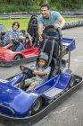 Boys and men go-karting — Stock Photo