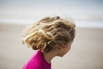 Six year old child on the beach — Stock Photo