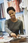 Woman working in design shop — Stock Photo