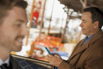 Professionals on the go, keeping in contact — Stock Photo