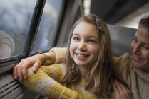 Woman and young girl in train — Stock Photo