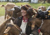 Farmer tending to the animals. — Stock Photo