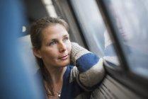 Woman at window seat in train — Stock Photo