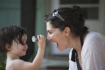 Mother and young daughter face to face — Stock Photo