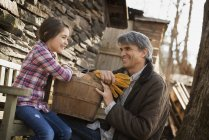 Man and a child on an organic farm. — Stock Photo