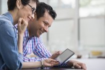 People using a digital tablet. — Stock Photo