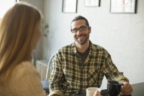 Man and woman talking in cafe — Stock Photo