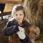 Girl with baby goat. — Stock Photo