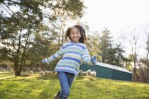 Girl in a  blue stripey top running — Stock Photo
