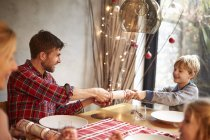 Family around table at Christmas time — Stock Photo