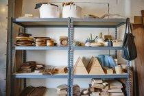 Shelves in a wood turner workshop — Stock Photo
