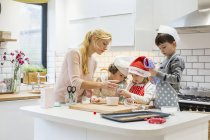 Woman and children working together — Stock Photo