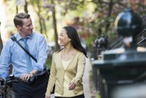 Businesswoman and businessman outdoors in city — Stock Photo
