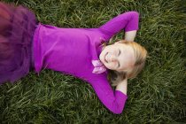 Young girl lying on her back — Stock Photo
