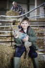 Little boy and newborn lamb — Stock Photo