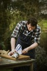 Chef filleting a fresh salmon. — Stock Photo