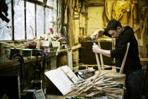 Man working in a furniture maker 's workshop — стоковое фото