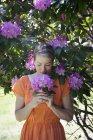 Woman holding purple flower head — Stock Photo