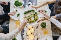 Human hands sharing a meal — Stock Photo