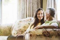 Senior couple sitting on a sofa. — Stock Photo