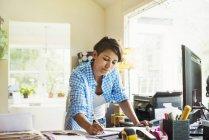Woman working at desk in interior studio — Stock Photo