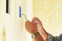 Senior man working on electrical wiring — Stock Photo
