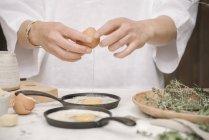 Woman preparing eggs for breakfast. — Stock Photo