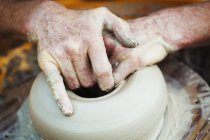 Woman potter working with clay — Stock Photo