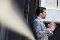 Businessman talking and gesturing with hands — Stock Photo