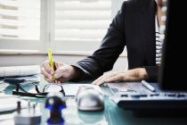 Businessman sitting at desk in an office — Stock Photo