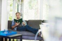 Man reading a book. — Stock Photo