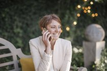 Woman using her mobile phone. — Stock Photo